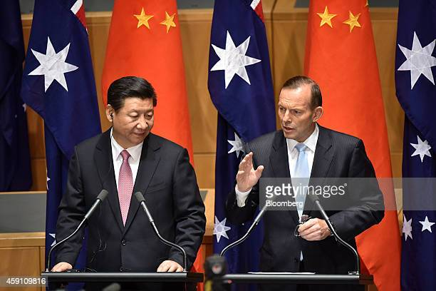 Tony Abbott Australia's prime minister right speaks as Xi Jinping China's president looks on while delivering a statement at Parliament House in...