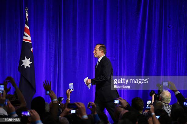 Tony Abbott Australia's prime ministerelect arrives on stage to deliver his victory speech at the LiberalNational coalition's election function in...