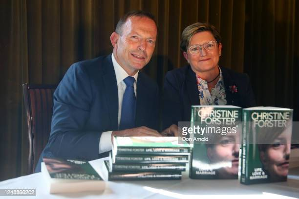 Tony Abbott poses alongside his sister Christine Forster during the launch of 'Life, Love & Marriage' by Christine Forster on June 11, 2020 in...