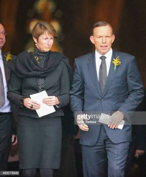 Tony Abbott Prime Minister of Australia and his wife Margie Abbott leave after attending a national memorial service as Australians mourn the loss of...