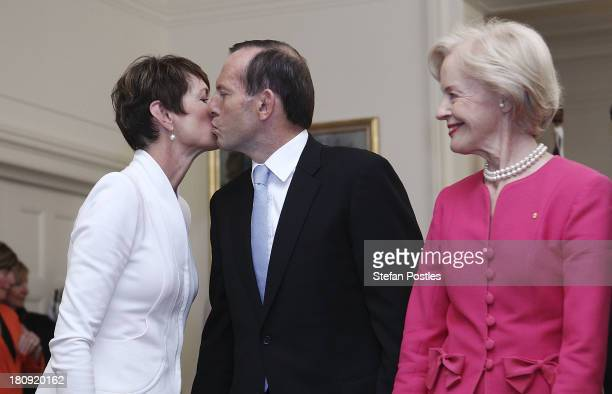 Tony Abbott receives a kiss from his wife Margie after being sworn in as the 28th Prime Minister of Australia by the GovernorGeneral Quentin Bryce on...