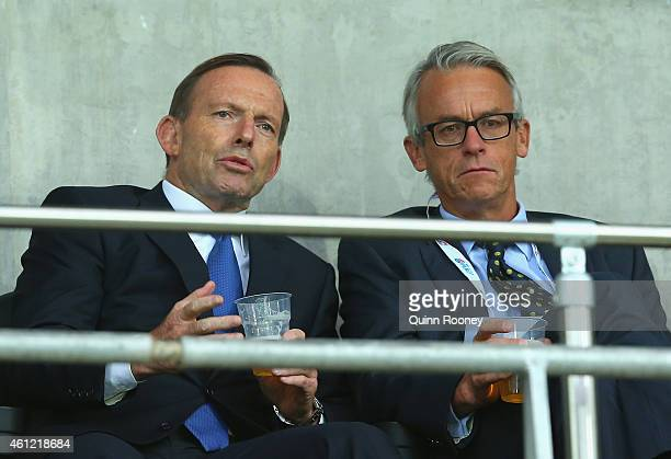 Tony Abbott the prime minister of Australia chats to David Gallop the chief executive of the Football Federation Australia during the 2015 Asian Cup...