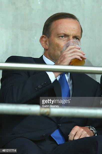 Tony Abbott the prime minister of Australia has a drink during the 2015 Asian Cup match between the Australian Socceroos and Kuwait at AAMI Park on...