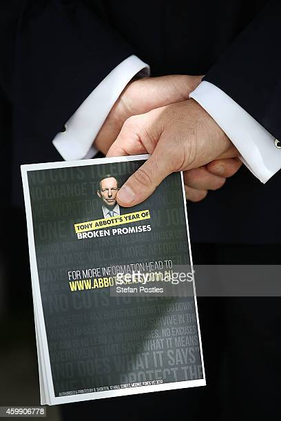 'Tony Abbott's Year of Broken Promises' book held during an opposition press conference at Parliament House on December 4 2014 in Canberra Australia...