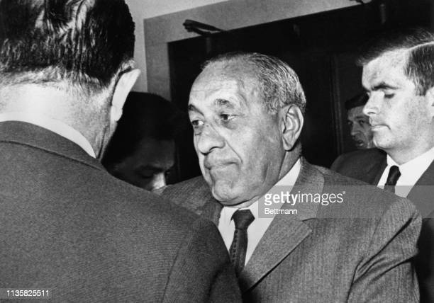Tony Accardo retired czar of the farflung empire of the old Capone mob confers with his lawyer before entering grand jury hearing in Chicago...