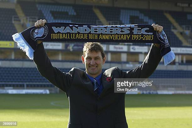 Tony Adams holds aloft the Wycombe scarf during a press conference to announce his position as the new manager for Wycombe Wanderers on November 5...