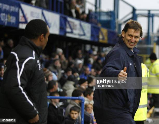 Tony Adams Manager of Portsmouth football club gestures to Manager of Blackburn Rovers Paul Ince before kick off during a Premier League football...