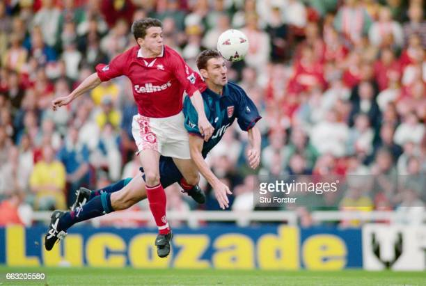 Tony Adams of Arsenal wins the ball ahead of Juninho of Middlesbrough during the FA Carling Premiership match between Middlesbrough and Arsenal at...