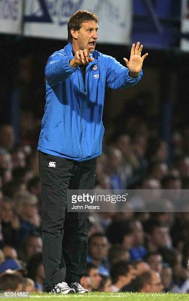 Tony Adams of Portsmouth shouts instructions from the touchline during the FA Premier League match between Portsmouth and Manchester United at...