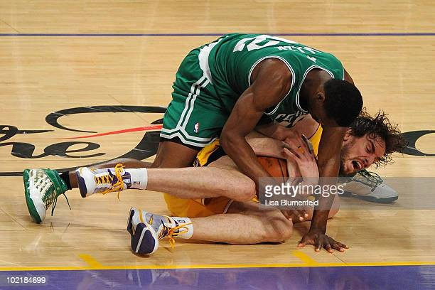 Tony Allen of the Boston Celtics dives on Pau Gasol of the Los Angeles Lakers in the third quarter of Game Seven of the 2010 NBA Finals at Staples...