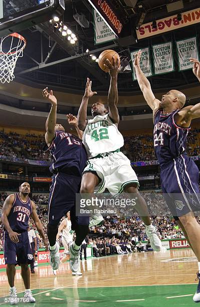 Tony Allen of the Boston Celtics goes hard to the basket against Vince Carter and Richard Jefferson of the New Jersey on April 14 2006 at the TD...