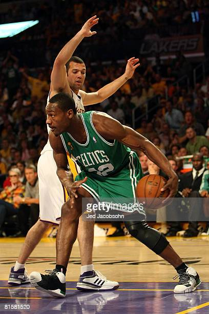 Tony Allen of the Boston Celtics moves around Jordan Farmar of the Los Angeles Lakers in Game Five of the 2008 NBA Finals on June 15 2008 at Staples...