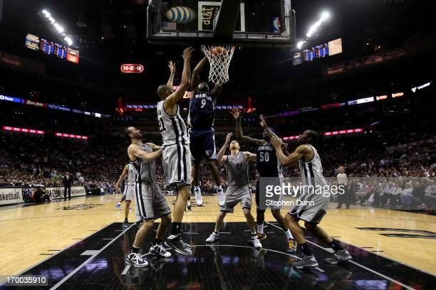 Tony Allen of the Memphis Grizzlies drives for a shot attempt against the Tim Duncan of the San Antonio Spurs during Game Two of the Western...