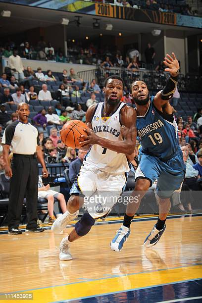 Tony Allen of the Memphis Grizzlies drives past Wayne Ellington of the Minnesota Timberwolves on April 2 2011 at FedEx Forum in Memphis Tennessee...
