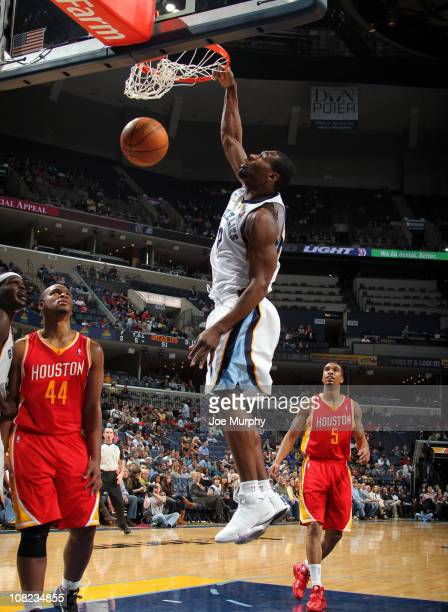 Tony Allen of the Memphis Grizzlies dunks against Chuck Hayes of the Houston Rockets on January 21 2011 at FedExForum in Memphis Tennessee NOTE TO...