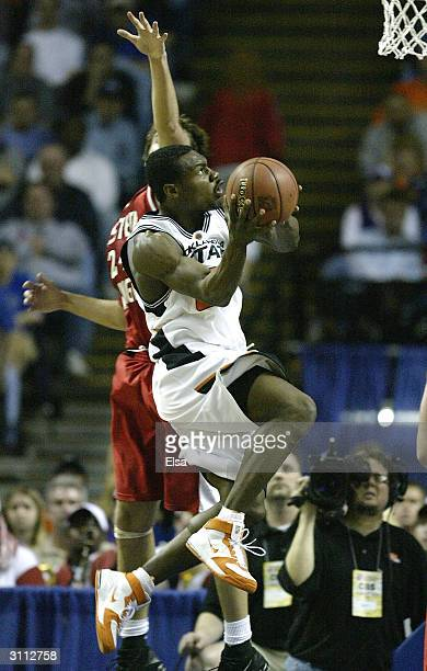 Tony Allen of the Oklahoma State Cowboys takes a shot past Marc Axton of the Eastern Washington Eagles during the first round game of the NCAA...