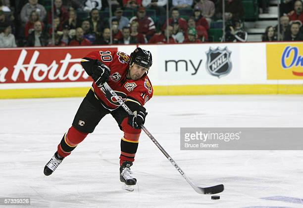 Tony Amonte of the Calgary Flames skates with the puck during the game against the Los Angeles Kings on March 29 2006 at the Pengrowth Saddledome in...