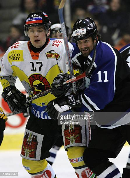 Tony Amonte of the Primus Worldstars takes the high stick from Christoph Roder of SC Bern on December 15, 2004 at Bern Arena in Bern Switzerland. The...