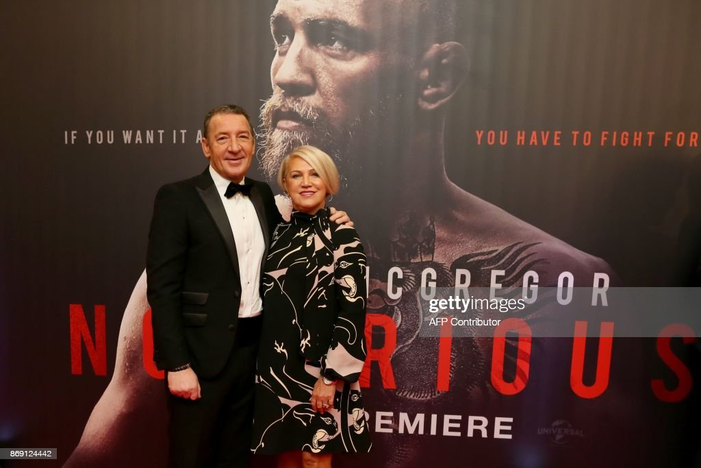 Tony and Margaret McGregor, parents of Irish mixed martial arts star Conor McGregor pose upon arrival to attend the world premiere of the documentary film 'Conor McGregor: Notorious' at the Savoy Cinema in Dublin, Ireland on November 1, 2017. / AFP PHOTO / Paul FAITH