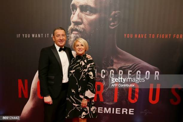 Tony and Margaret McGregor parents of Irish mixed martial arts star Conor McGregor pose upon arrival to attend the world premiere of the documentary...