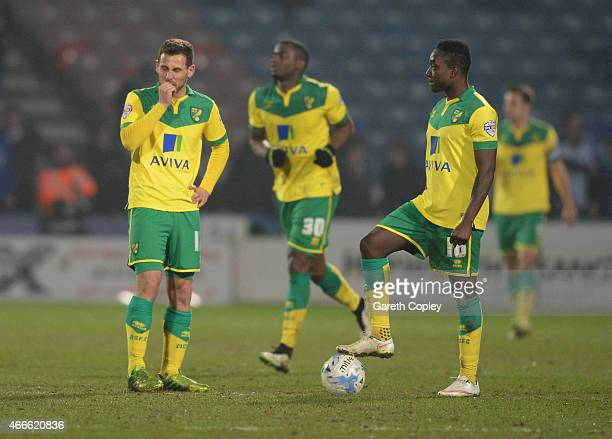 Tony Andreu and Jamar Loza of Norwich City look dejected as James Vaughan of Huddersfield Town scores their second goal during the Sky Bet...