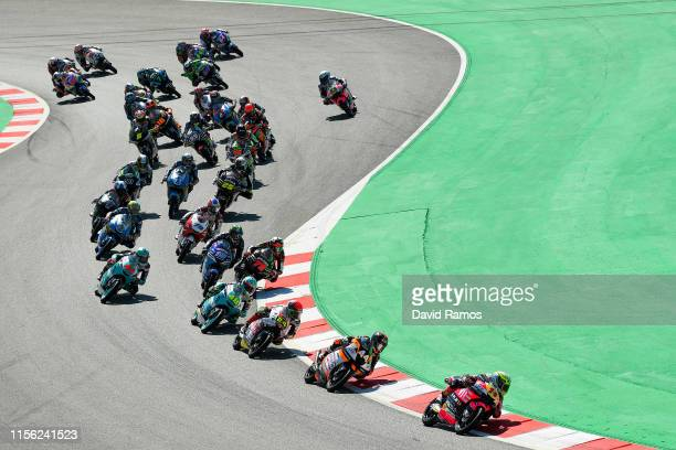 Tony Arbolino of Italy and VNE Snipers leads the pack at the start of the Moto3 race during the MotoGP Gran Premi Monster Energy de Catalunya at...