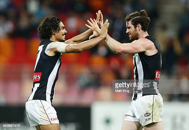 Tony Armstrong and Tyson Goldsack of the Magpies celebrate victory after the round 22 AFL match between the Greater Western Sydney Giants and the...