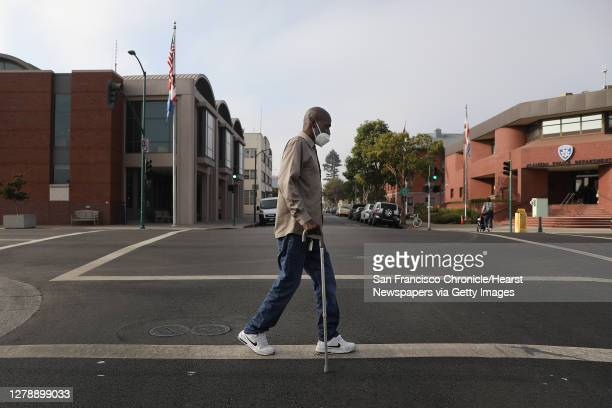 Tony Armstrong of Alameda crosses Oak Street during his daily walk through his neighborhood on Monday, October 5, 2020 in Alameda, Calif. Armstrong...