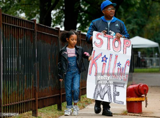 Tony Austin and his granddaughter Rocky leave a protest for the murder trial of Chicago police officer Jason Van Dyke outside the Leighton Criminal...