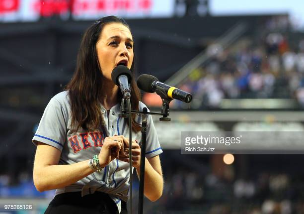 Tony Award winning actress Lena Hall performs the national anthem before a game between the New York Yankees and New York Mets at Citi Field on June...