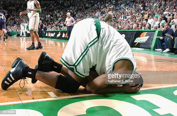 Tony Battie of the Boston Celtics falls to the floor against the New Jersey Nets in Game four of the Eastern Conference Semifinals during the 2003...