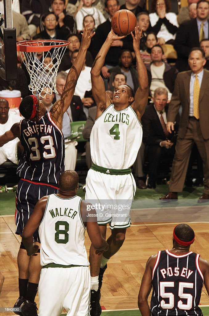 Tony Battie #4 of the Boston Celtics goes up for the shot against Eddie Griffin #33 of the Houston Rockets during the NBA game at Fleet Center on February 24, 2003 in Boston, Massachusetts. The Rockets won in overtime 101-95.