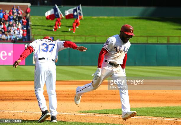 Tony Beasley of the Texas Rangers congratulates Delino DeShields for hitting a stand slam in the fourth inning against the Chicago Cubs at Globe Life...