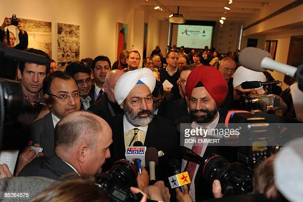 Tony Bedi a representative for winning bidder Vijay Mallya who owns Kingfisher beer speaks to the media after a controversial auction of Mahatma...