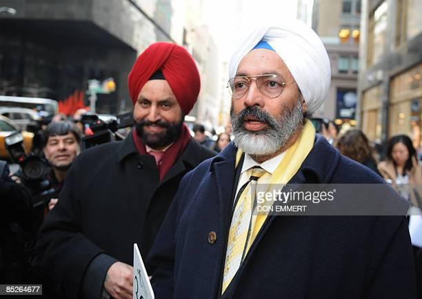 Tony Bedi a representative for winning bidder Vijay Mallyawho owns Kingfisher beerand Indian businessman Sant Chatwal walk down the street after a...