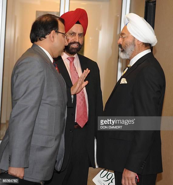 Tony Bedi and Atil Kumari representatives for winning bidder Vijay Mallya who owns Kingfisher beer along with Indian businessman Sant Chatwal have a...