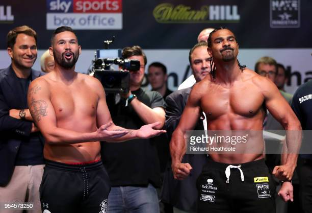 Tony Bellew and David Haye weigh in as Eddie Hearn looks on during the Weigh in ahead of the Heavyweight fight between Tony Bellew and David Haye at...