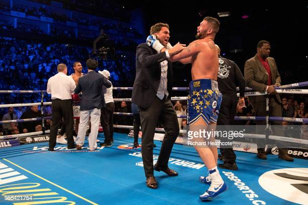Tony Bellew celebrates victory over David Haye with promotor Eddie Hearn during the Heavyweight contest between Tony Bellew and David Haye at The O2...