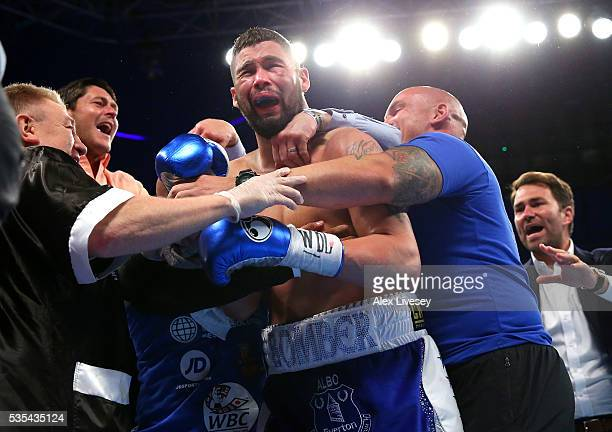 Tony Bellew celebrates with his corner after stopping Illunga Makabu in the second round to win the Vacant WBC World Cruiserweight Championship fight...