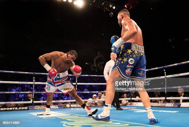 Tony Bellew delivers a left hook to floor David Haye in the 5th round during the Heavyweight contest between Tony Bellew and David Haye at The O2...
