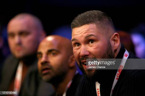 Tony Bellew, manager of Jazza Dickens and Dave Coldwell, manager Leigh Wood look on from ringside during MTK Global Golden Contract Featherweight...