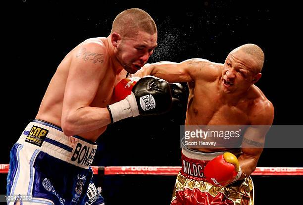 Tony Bellew of England is caught by Isaac Chilemba of Malawi during their WBC Silver Light Heavyweight Championship and World Final Eliminator bout...
