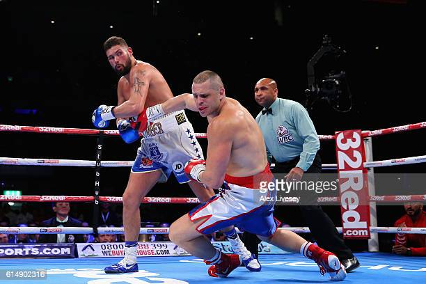 Tony Bellew of England lands a left hand punch on BJ Flores of USA in the WBC Cruiserweight Championship match during Boxing at Echo Arena on October...