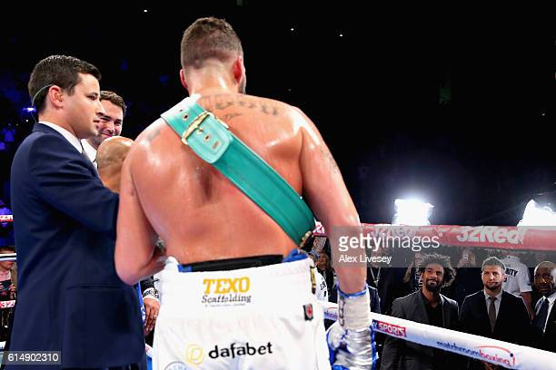 Tony Bellew of England talks to heavyweight boxer David Haye after winning in the WBC Cruiserweight Championship match during Boxing at Echo Arena on...