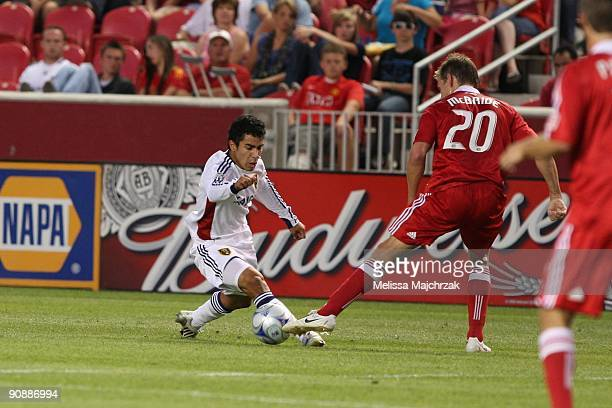 Tony Beltran of Real Salt Lake fights for the ball against Brian McBride of Chicago Fire at Rio Tinto Stadium on September 12 2009 in Sandy Utah
