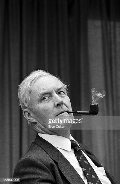 Tony Benn Labour Party MP smokes his pipe as he listens during a conference at the Marina Leisure Centre in Great Yarmouth UK in May 1998 Benn was...
