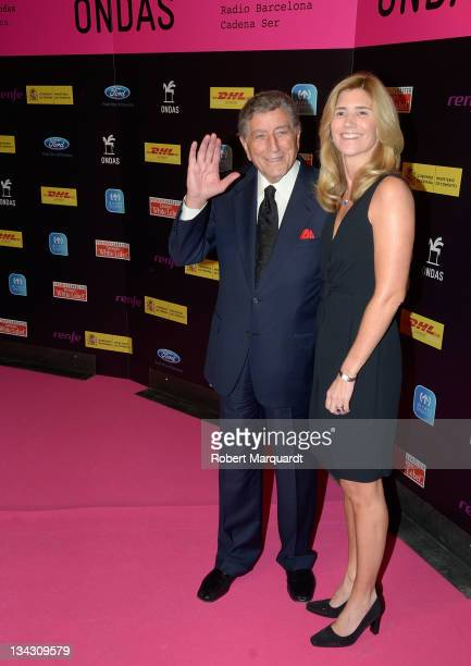 Tony Bennet and guest pose during the photocall for the 58th Ondas Awards 2011 at the Palauet Albeniz on November 30 2011 in Barcelona Spain