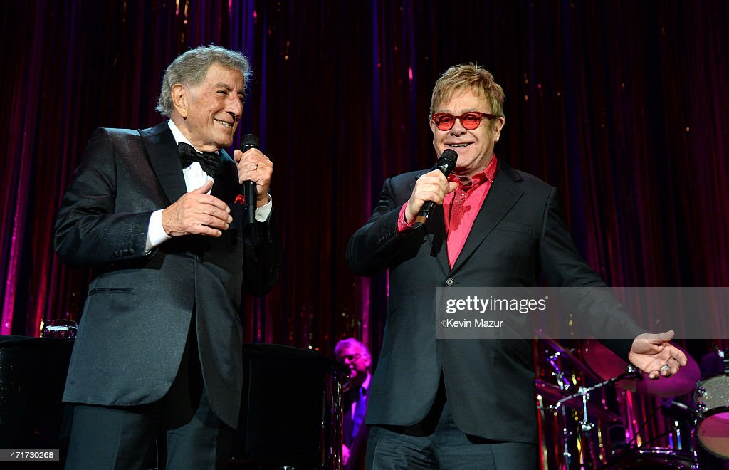 Tony Bennett and Elton John perform onstage during Breast Cancer Research Foundation's Hot Pink Party: The Pink Standard at Waldorf Astoria Hotel on April 30, 2015 in New York City.