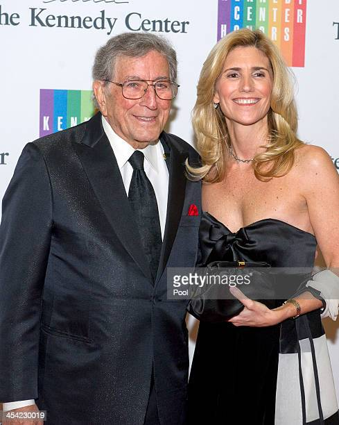 Tony Bennett and his wife Susan Crow arrive at the formal Artist's Dinner honoring the recipients of the 2013 Kennedy Center Honors hosted by United...