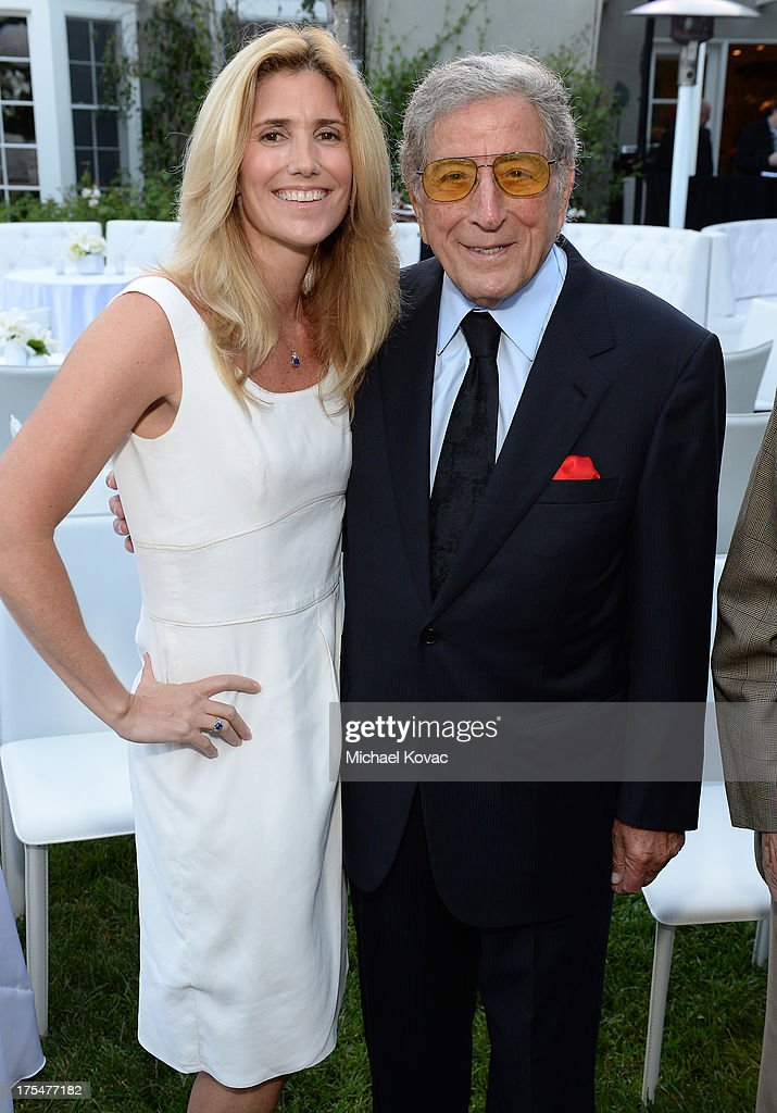 Tony Bennett (R) and Susan Benedetto attend the 87th birthday celebration of Tony Bennett and fundraiser for Exploring the Arts, the charity organization founded by Mr. Bennett and wife Susan Benedetto, hosted by Ted Sarandos & Nicole Avant Sarandos among celebrity friends and family on August 3, 2013 in Beverly Hills, California.